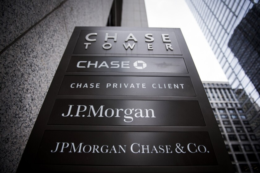 Close up of signage stands on display outside the JPMorgan & Chase Tower in downtown Chicago, Illinois, U.S., on Saturday, Oct. 7, 2017.