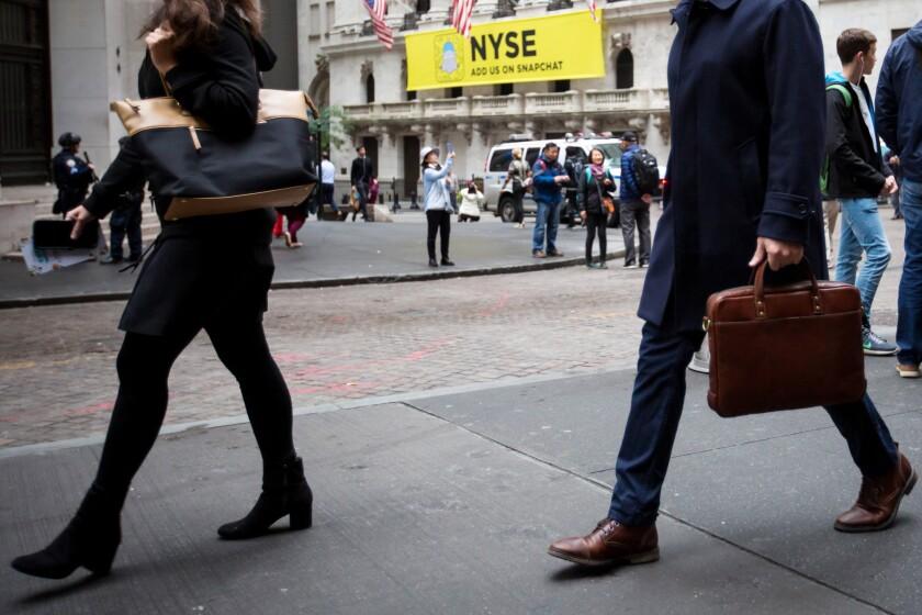 People walking in front of Stock Exchange New York Bloomberg News.jpg
