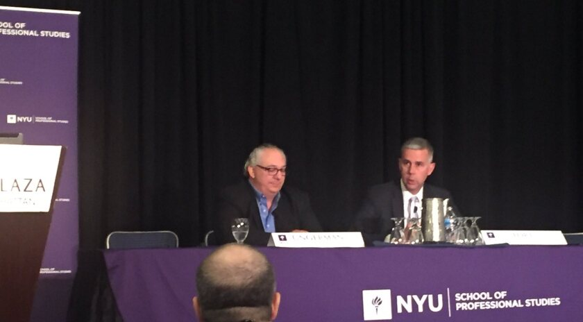 IRS Criminal Investigation chief Don Fort (right), is interviewed by Josh O. Ungerman, a partner at Meadows, Collier, Reed, Cousins, Crouch & Ungerman, at the NYU Tax Controversy Forum