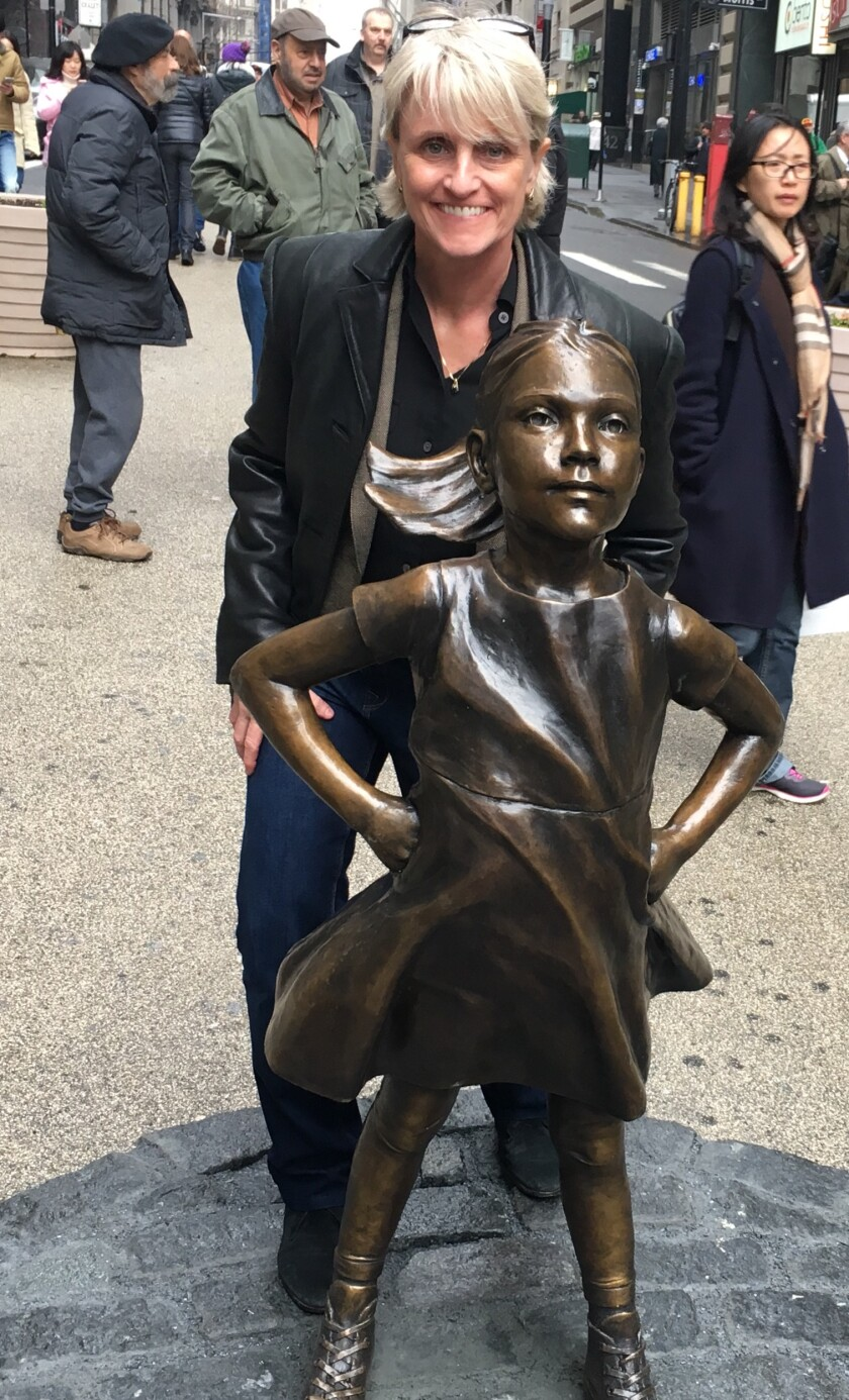 Adviser Carolyn McClanahan visited by A Brave Girl statue in New York