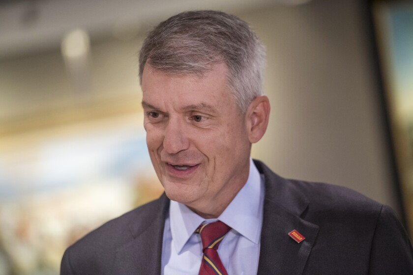 Tim Sloan, CEO of Wells Fargo, speaks with a reporter before a Bloomberg Television interview in San Francisco, May 23, 2017