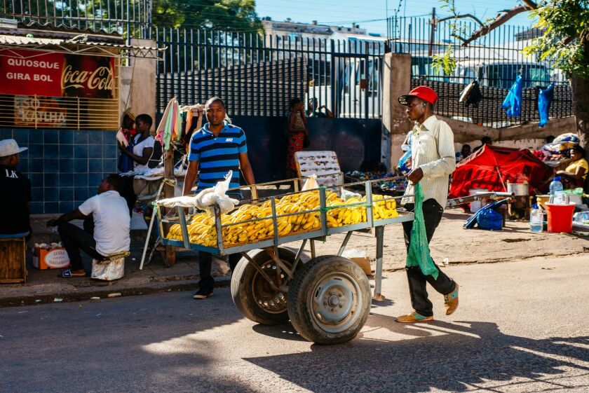 A street trader wheels a cart laden with bananas along a street in Maputo, Mozambique, on Thursday, March 23, 2017. Mozambique missed a $119 million payment due Tuesday on a loan Credit Suisse Group AG arranged, the second debt repayment the government failed to make in as many months. Photographer: Waldo Swiegers/Bloomberg