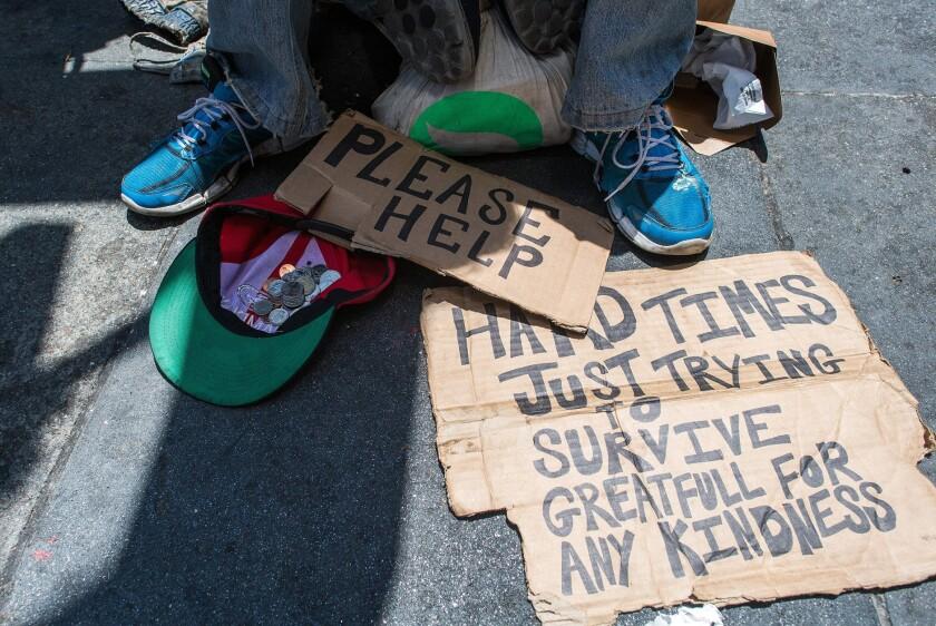 Andrew Loy begs along a sidewalk in downtown San Francisco
