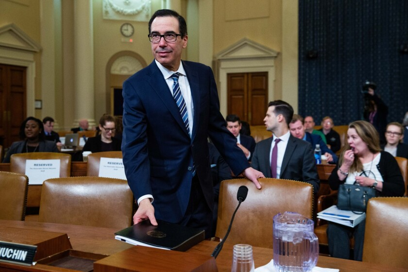 U.S. Treasury Secretary Steven Mnuchin arrives to testify during a House Ways and Means Committee hearing in Washington, D.C.