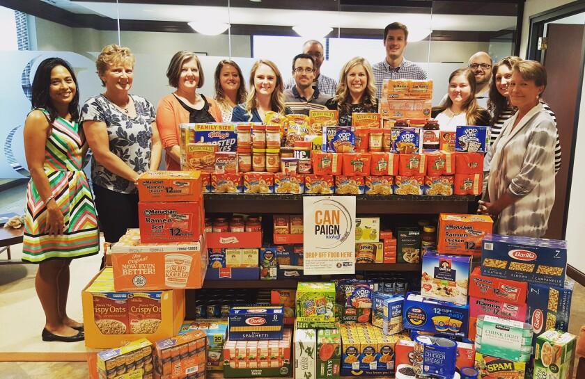 Smith Leonard staff with donated food