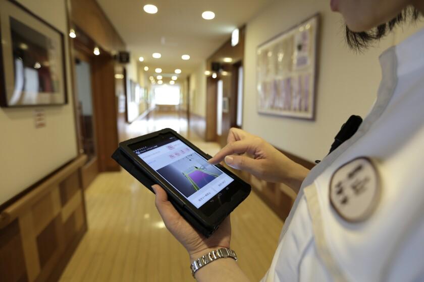 Handheld in nursing home-CROP.jpg