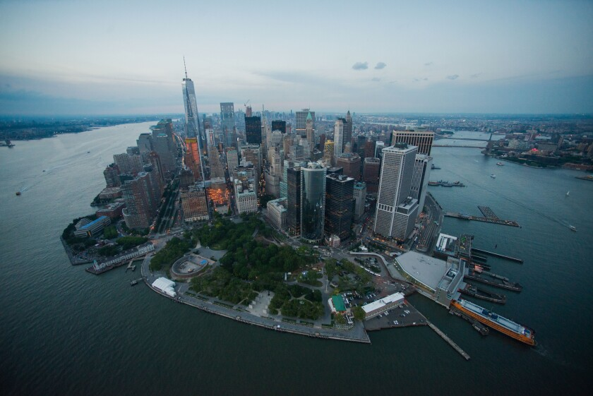 One World Trade Center stands the Lower Manhattan skyline at dusk in this aerial photograph taken above New York, U.S., on Friday, June 19, 2015.