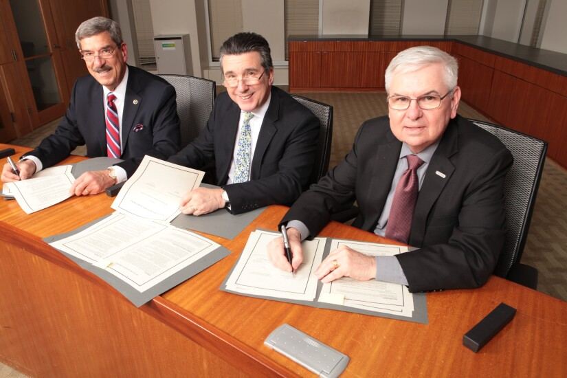 NASBA president and CEO Ken Bishop (left), ICAS CEO Anton Colella, and AICPA president and CEO Barry Melancon sign a mutual recognition agreement