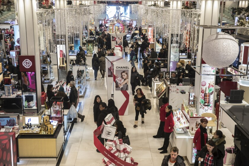 Shoppers walk through a Macy's department store in New York