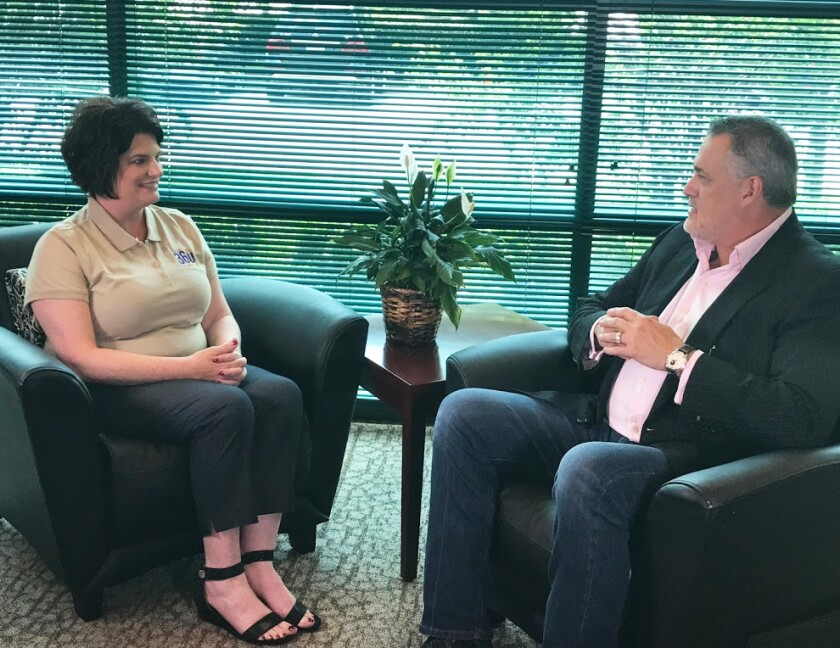 The woman is Nicole Ossenfort, the CEO of 360 Accounting Solutions. She is talking to consultant Jeffrey Hayzlett