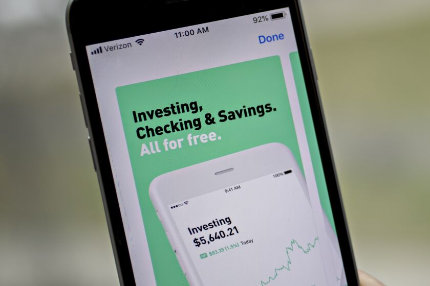 The Robinhood application is displayed in the App Store on an Apple Inc. iPhone in an arranged photograph taken in Washington, D.C., U.S., on Friday, Dec. 14, 2018. The Securities Investor Protection Corp. said a new checking account from Robinhood Financial LLC raises red flags and that the deposited funds may not be eligible for protection. Photographer: Andrew Harrer/Bloomberg