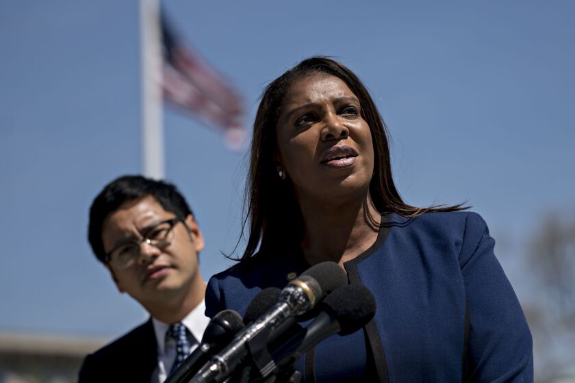 Letitia James, New York attorney general, right, speaks to members of the media as Dale Ho, director of the American Civil Liberties Union (ACLU) voting rights project, listens outside the U.S. Supreme Court after oral arguments in the Department of Commerce v. New York, 18-966, case in Washington, D.C., U.S., on Tuesday, April 23, 2019. Key Supreme Court justices seemed inclined to let the Trump administration add a question about citizenship to the 2020 census in a clash that will shape the allocation of congressional seats and federal dollars. Photographer: Andrew Harrer/Bloomberg