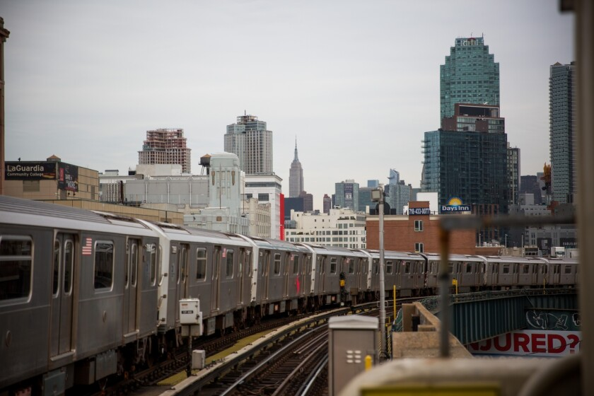 A 7 subway train runs along elevated tracks in the Queens borough of New York.