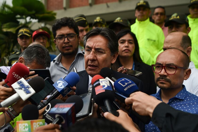 Colombian Attorney General Nestor Humberto Martinez speaks to the press after the identification of slain Ecuadorean El Comercio journalist Javier Ortega, photographer Paul Rivas, and driver Efrain Segarra.