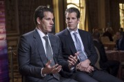 Cameron Winklevoss, chief executive officer and co-founder of Gemini Trust Company LLC, left, speaks as Tyler Winklevoss, chief financial officer and co-founder of Gemini Trust Company LLC, listens.