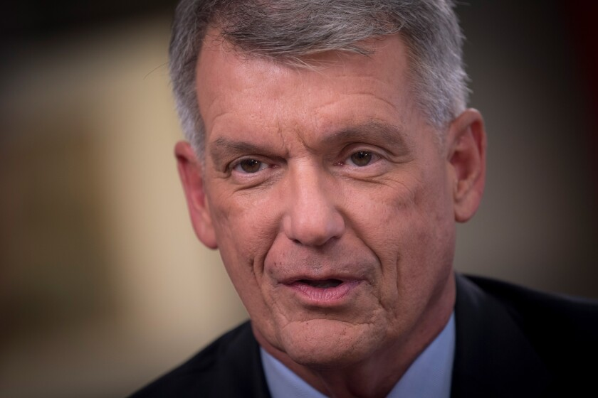 Tim Sloan, president and chief executive officer of Wells Fargo & Co., speaks during a Bloomberg Television interview in San Francisco, California, U.S., on Monday, May 21, 2018. Sloan said the firm is ready to increase lending for car sales after pulling back last year, and its now looking with consternation at the commercial real estate market. Photographer: David Paul Morris/Bloomberg