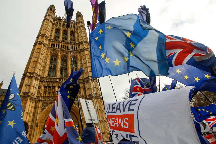 Anti and pro-Brexit demonstrators wave European Union (EU), British Union flags, also known as Union Jacks, and banners during protests outside the Houses of Parliament in London.
