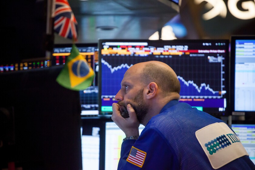The downward stock market move was sparked by U.S. wage data on Friday.