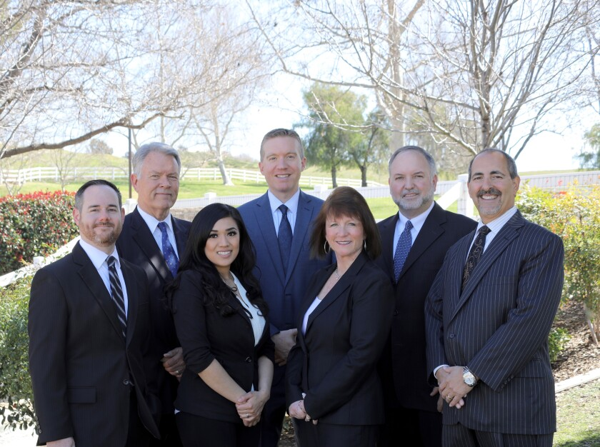 Stifel recently picked up a former Merrill Lynch team that oversaw nearly $600 million in client assets. From left to right: Ron Benoit, Greg Munro, Coni Resendiz, Robert Babcock, Peg Allen, Tony Ondracek and Gary Allen.