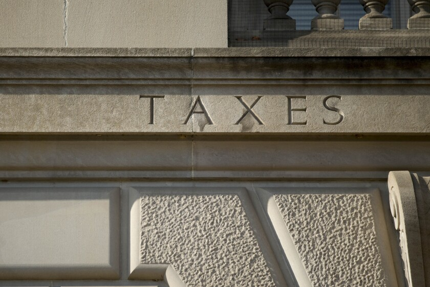 """The word """"taxes"""" is engraved on the side of IRS headquarters in Washington, D.C."""