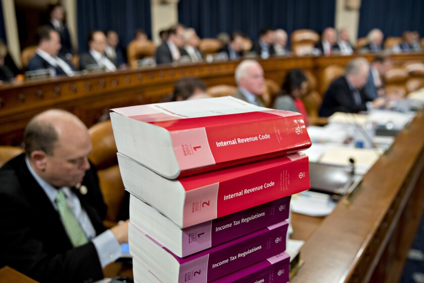 Internal Revenue Code books sit during a House Ways and Means Committee markup hearing in Washington, D.C.