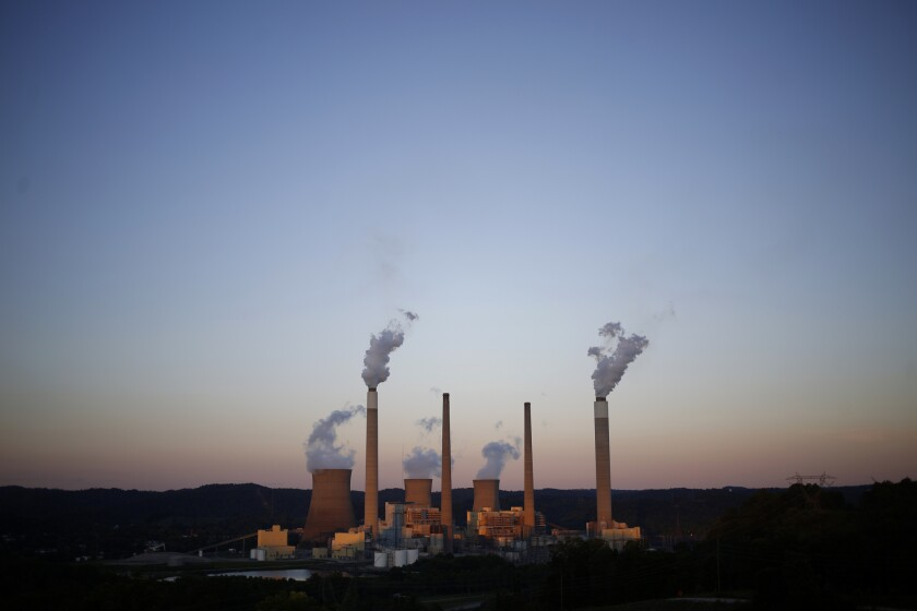 Emissions rise from the American Electric Power Co. coal-fired John E. Amos Power Plant in Winfield, West Virginia.