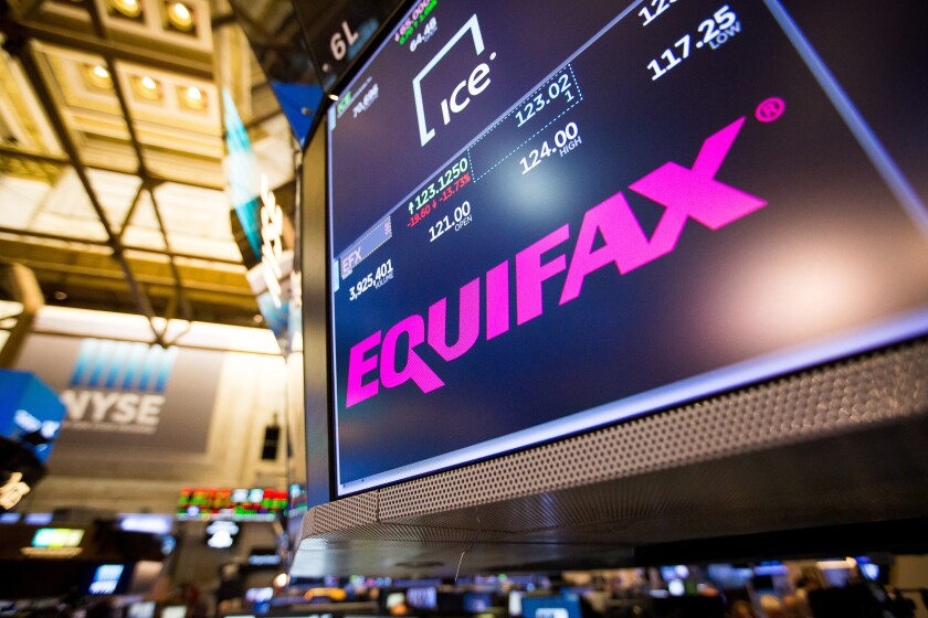 A monitor displays Equifax signage on the floor of the New York Stock Exchange.