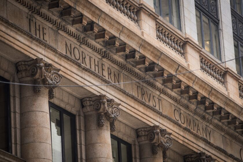 Signage is displayed on the exterior of a Northern Trust Corp. branch in Chicago, Illinois, U.S, on Thursday, July 13, 2017. Northern Trust Corp. is scheduled to release earnings figures on July 19. Photographer: Christopher Dilts/Bloomberg