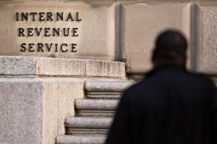 A man walks past the IRS headquarters in Washington, D.C.