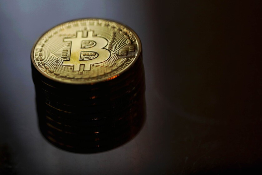 Bitcoin fell as much as 18% against the dollar to $978.76 after the decision from the SEC.