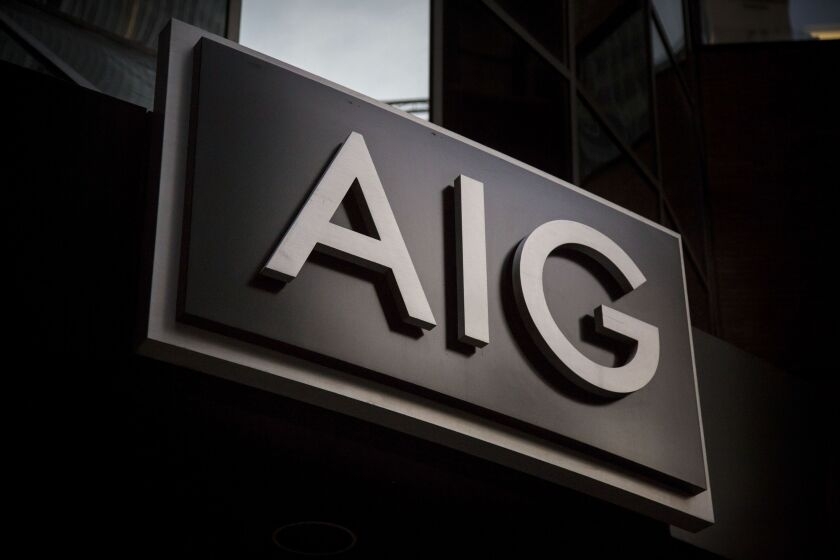 American International Group Inc. (AIG) signage stands outside the company's headquarters in New York, U.S., on Thursday, Oct. 29, 2015. AIG is scheduled to announce third-quarter earnings figures on November 2. Photographer: Michael Nagle/Bloomberg
