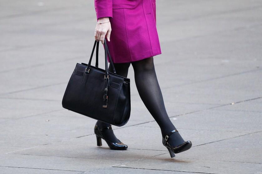woman-worker-briefcase-bloomberg-iag-2016