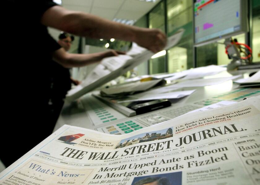 A printer checks copies of the Wall Street Journal in Rainham, Essex, U.K., on Wednesday, April 16, 2008. Bloomberg News.