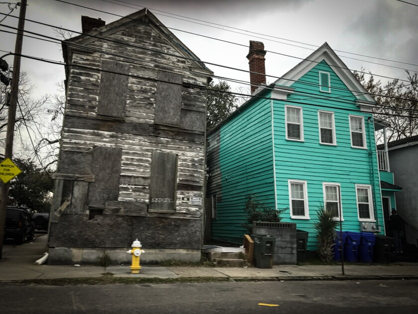 Poor neighborhood, turquoise house, boarded up house