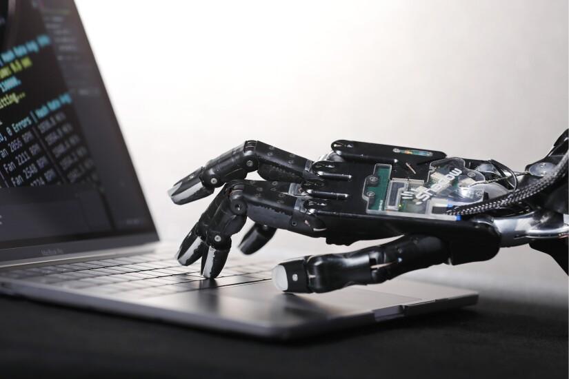 Robotic hand on a keyboard