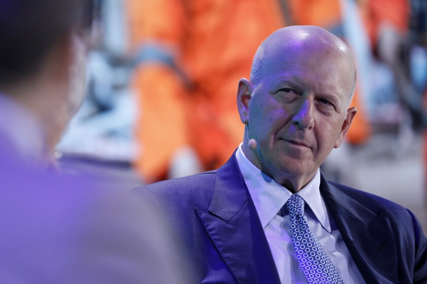 David Solomon, chief executive officer of Goldman Sachs & Co., listens during a panel discussion at the Bloomberg New Economy Forum in Singapore, on Wednesday, Nov. 7, 2018. The New Economy Forum, organized by Bloomberg Media Group, a division of Bloomberg LP, aims to bring together leaders from public and private sectors to find solutions to the world's greatest challenges. Photographer: Justin Chin/Bloomberg