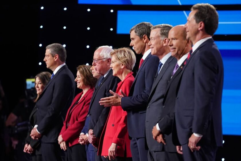 Democratic presidential candidates Marianne Williamson, (L-R),  Rep. Tim Ryan (D-Ohio), Sen. Amy Klobuchar (D-Minn.), Indiana Mayor Pete Buttigieg, Sen. Bernie Sanders (I-Vt.), Sen. Elizabeth Warren (D-Mass.), former Texas congressman Beto O'Rourke,  former Colorado governor John Hickenlooper, former Maryland congressman John Delaney, and Montana Gov. Steve Bullock.