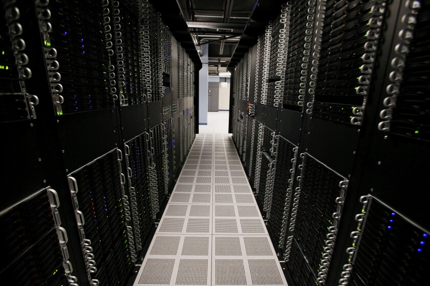 Servers and hard drives stand inside pod one of IBM's Softlayer data center in Dallas.