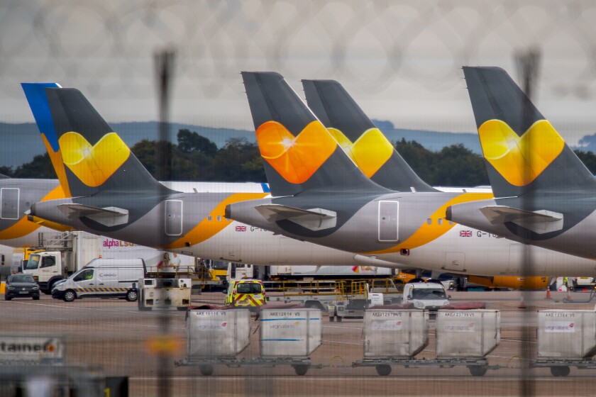 Passenger aircraft operated by Thomas Cook Group Plc sit on the tarmac at Manchester Airport in Manchester, U.K., on Monday, Sept. 23, 2019. Photographer: Anthony Devlin/Bloomberg