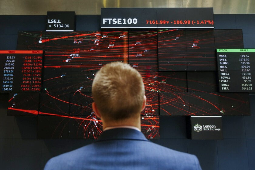 An employee views a FTSE 100 share index board in the atrium of the London Stock Exchange Group Plc's offices in London, U.K., on Wednesday, May 29, 2019. While the FTSE 100 Index has climbed about 15 percent since June 2016 in local currency, it's down in both euro and dollar terms. Photographer: Luke MacGregor/Bloomberg