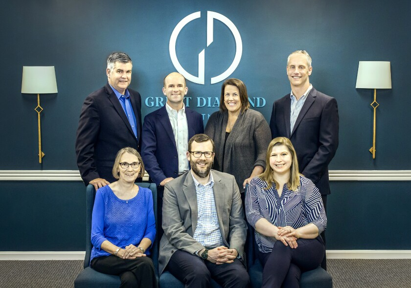 Great Diamond Partners left UBS to open an independent firm in Portland, Maine. From left to right, standing: Joseph Powers, Jack Piper, Helen Andreoli, Steven Tenney. Sitting left to right: Susan Welsch, Andrew Scott, Meg Scott.