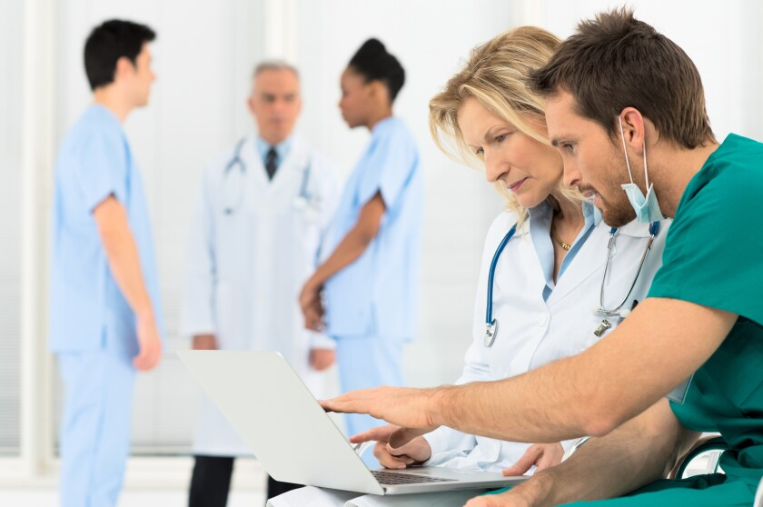 Doctors working on laptop.jpeg
