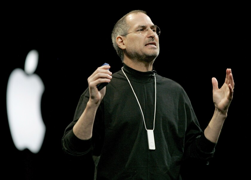 Steve Jobs, CEO of Apple Computer Inc., wears an iPod Shuffle around his neck during his keynote at Macworld in San Francisco  on January 11, 2005.