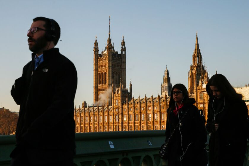 Pedestrians cross Westminster Bridge in view of the Houses of Parliament in London, U.K., on Tuesday, Dec. 11, 2018. Faced with a Brexit vote she can't win, U.K. Prime Minister Theresa May appears to be gambling that running down the clock to a no-deal departure might change the arithmetic in Parliament. Photographer: Luke MacGregor/Bloomberg