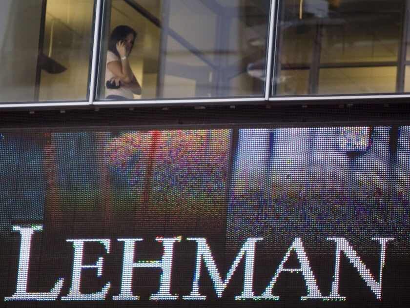 "A woman talks on a cell phone inside the headquarters of Lehman Brothers Holdings Inc., in New York, U.S., on Sept. 15, 2008. Two weeks after Lehman Brothers' bankruptcy triggered a global credit crisis, Morgan Stanley countered concerns that it might be next to go by announcing it had ""strong capital and liquidity positions."" Photographer: Jeremy Bales/Bloomberg"