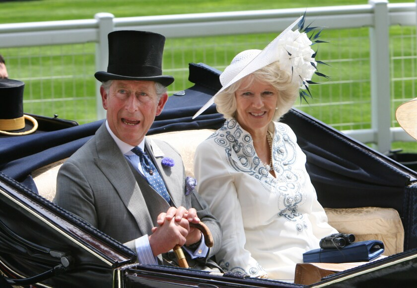 Charles, the Prince of Wales, and Camilla, the Duchess of Cornwall, arrive by carriage at the Royal Ascot horse race