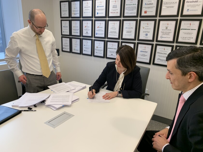 Liz Nesvold signs contract to join Raymond James.