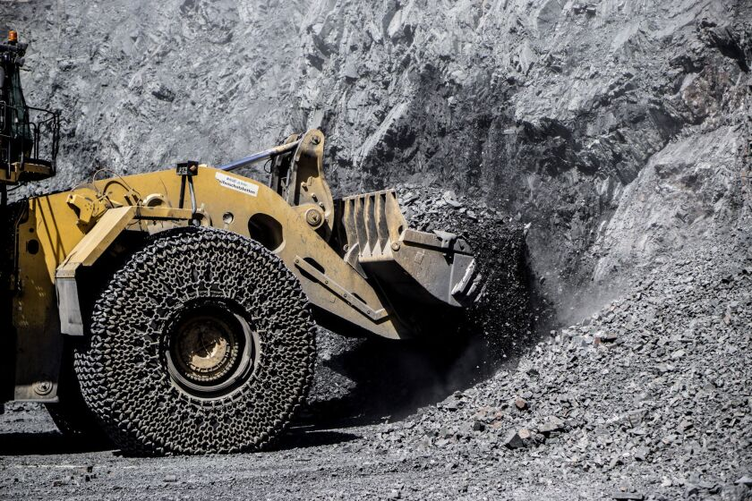 A front loader scoops up freshly blasted rock containing iron ore at the Yeristovo and Poltava iron ore mine, operated by Ferrexpo Poltava Mining PJSC, in Poltava, Ukraine.
