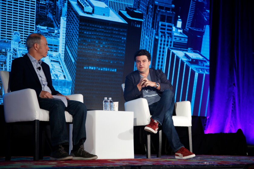 Noah Kerner, CEO of Acorns (right), speaking during a session at In|Vest 2018 in New York.