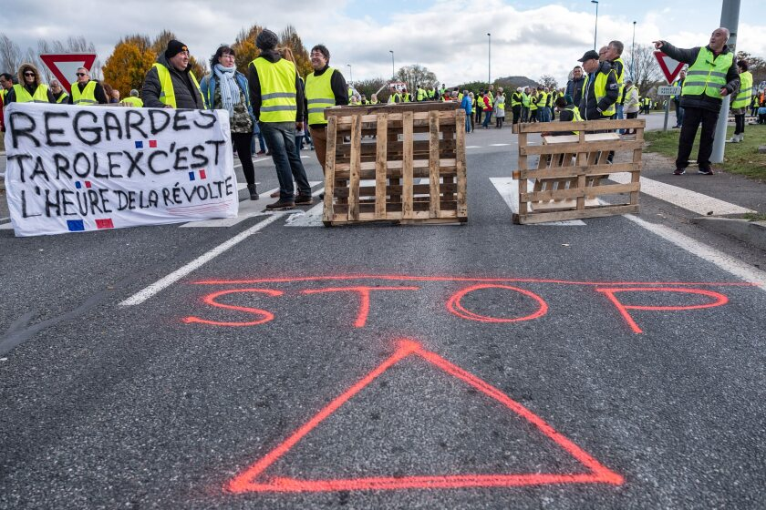 Demonstrators wearing yellow vests (Gilets jaunes) block the highway during a protest against fuel costs near Rodez, France.
